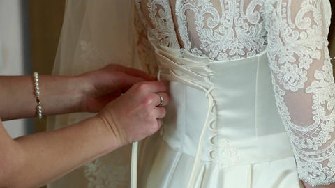 helps lace up the bride dress Footage