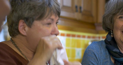 Woman wiping tears of joy with her two other friends all over 60 laughing and Footage