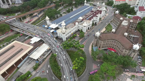 Aerial View at Busy Highway Road Junction and Railway Station in Malaysia. 4K Footage