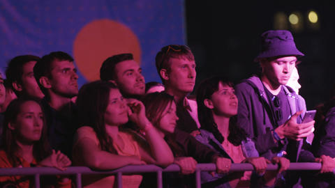People Crowd Watch Enjoy Rock Band Performance on Festival Footage