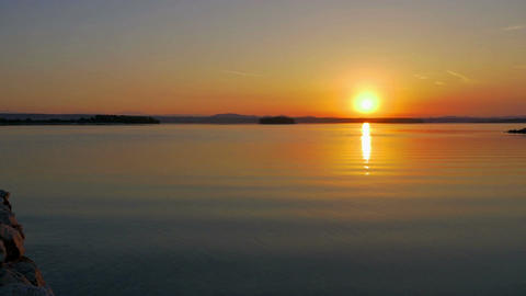 Early morning sunrise panorama view at calm sea beach. Shot in slow-motion hd Footage
