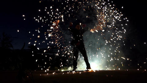 Fantastic fire show in the night with bengals light in slow motion Footage