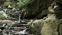small waterfall in mountains recorded in slow motion Footage