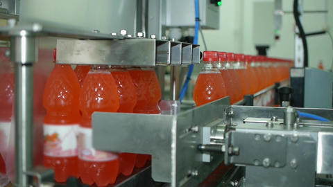 The production line of mineral water and carbonated drinks in PET packaging Footage