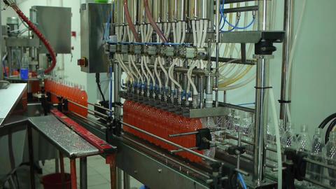 Bottling of lemonade in plastic bottles. Lemonade bottle conveyor industry Live Action