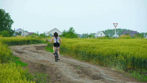 healthy lifestyle woman riding a bike on rural road Stock Video Footage
