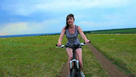 healthy lifestyle girl playing sports on the bike Footage
