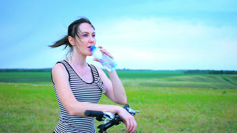 Young girl is drinking mineral water,Portrait of a young... Stock Video Footage