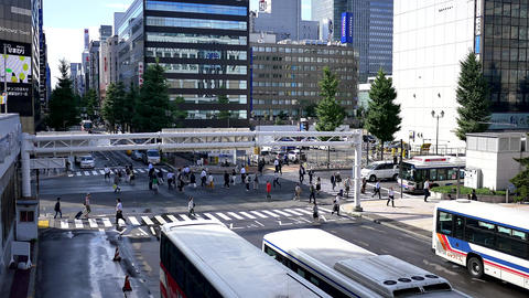 Wide shot of people walking at a cross road junction Footage