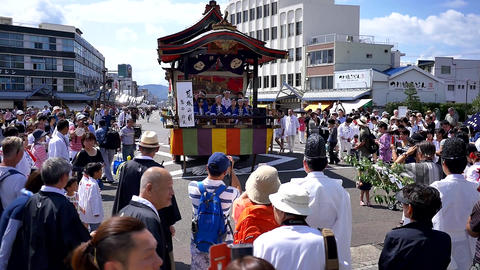 Wide shot of a Japanese drum performance celebrating a local festival Live Action
