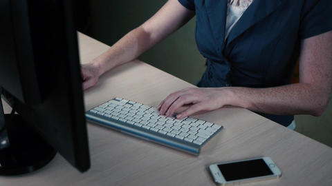 woman in glasses works behind a computer Footage