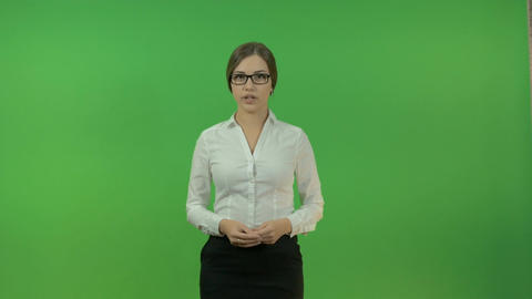Business lady gesturing with hands on a green background. Presentation Footage