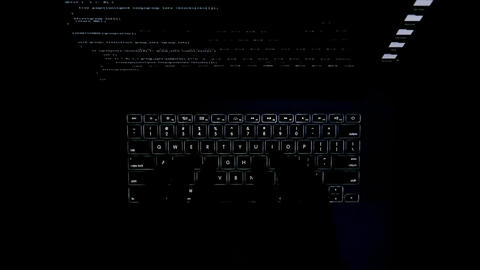 The computer keyboard glows in the dark. Keyboard backlight. The fingers are Footage
