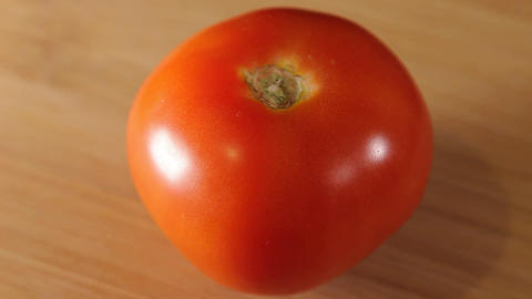 one ripe, juicy tomato Footage