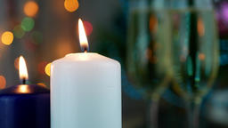 Candles are burning over holiday bokeh Footage
