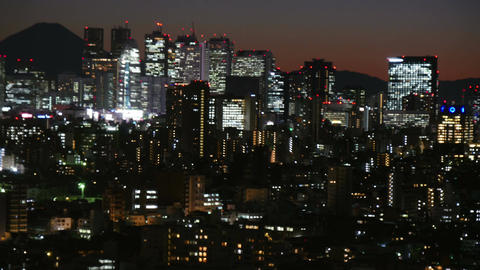 High angle timelapse of twilight skies over Shinjuku and Mt.Fuji Footage