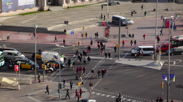 Pedestrians cross Avenida del Parallel at Plaza de Espanya, telephoto view Footage