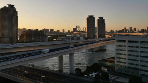 High angle timelapse skies over the Rainbow Bridge and city skyline Footage