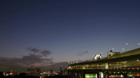 Twilight timelapse of commuter illumination over the Rainbow Bridge Footage
