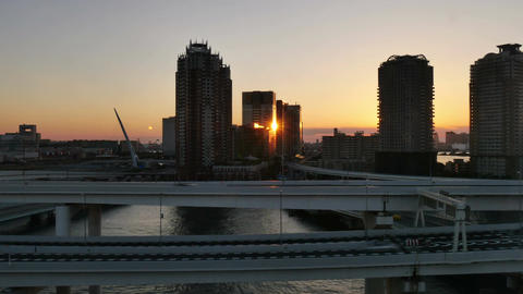Sunset timelapse over the junction and buildings of Odaiba Footage