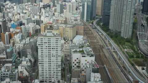 High angle timelapse of rapid public transportation in Shimbashi Area Footage