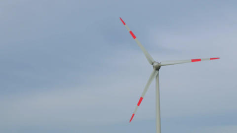 Regular wind turbines rotating in the wind on an blue sky Footage