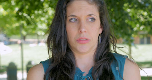 Displeased embarrassed concerned woman in her early 30s looking around outside Footage