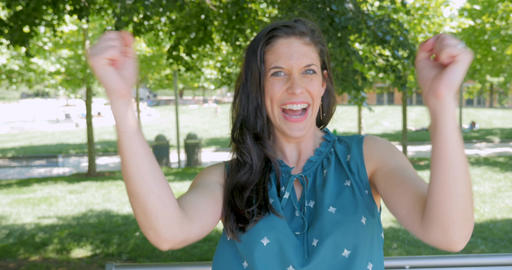 Beautiful attractive woman in 30s celebrating smiling and shouting has a Footage