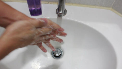 Washing male hands with soap in a basin Footage