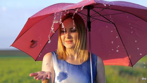 portrait of a beautiful girl with a red umbrella in the sunset smiling emotions Footage