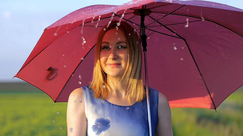 portrait of a beautiful girl with a red umbrella in the... Stock Video Footage