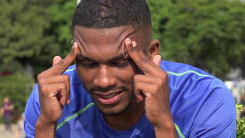 Black Male Athlete Massaging Temples Live Action
