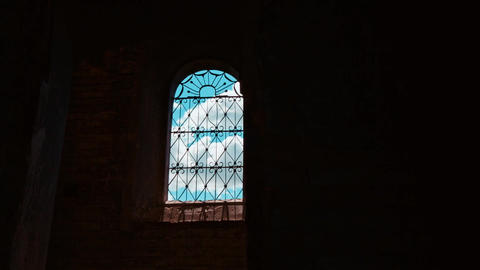 View on blue sky through the window of an old building Bild