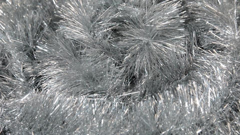 Close-up of the rotation of silver tinsel. Christmas background, tinsel Footage