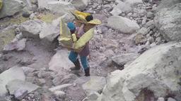 Sulfur worker, Mount Kawah Ijen volcano Footage
