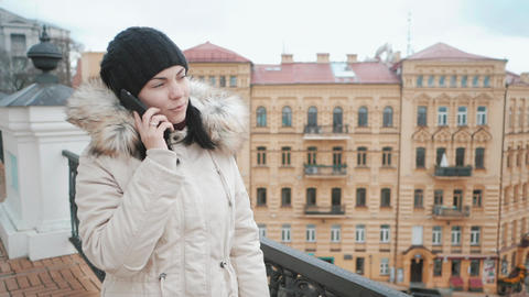 girl talking on the phone city in winter Footage