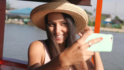 Young Happy Mixed Race Tourist Woman Floating on Wooden Thai Boat and Taking ビデオ