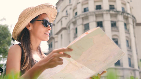 Attractive Young Tourist Girl with City Map Look Around. 4K, Slow Motion Footage