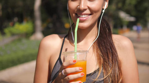 Young Mixed Race Runner Girl Drinking Fresh Orange Juice after Workout in City Footage