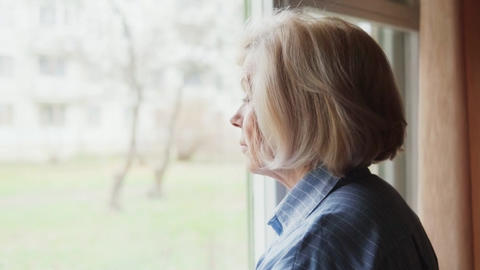elderly woman looking out the window Live Action