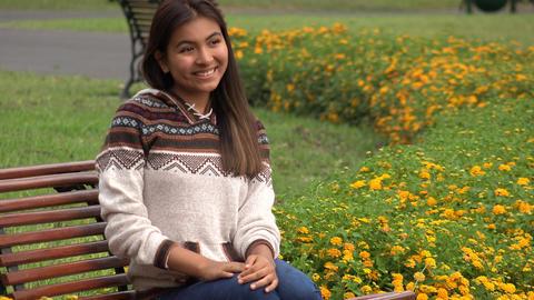 Happy Latina Hispanic Teen Sitting In Park Live Action
