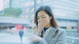 business woman coughing and sneezing at outdoor in the city Live影片