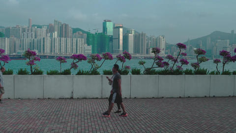 Hong Kong - People walking and jogging at Hung Hom Promenade with harbour and Footage