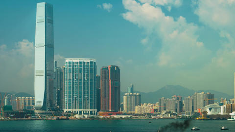 Hong Kong - Time lapse view of Victoria Harbour with boat traffic and high-rise Footage