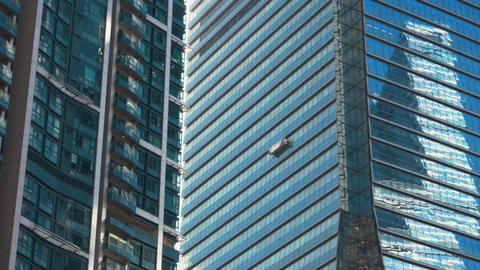 Hong Kong -Window cleaning suspended platform on International Commerce Centre Footage