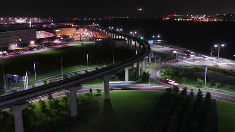 Nightlapse of landing airplanes and illumination surrounding the airport Footage