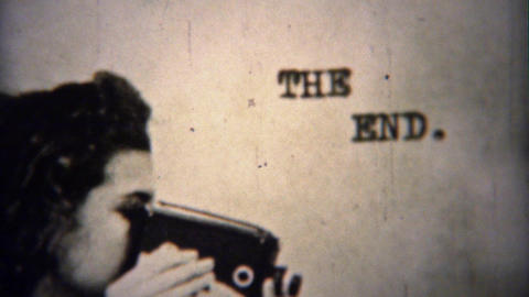 1962: The End Leader Shot Women Filming Movie Camera stock footage