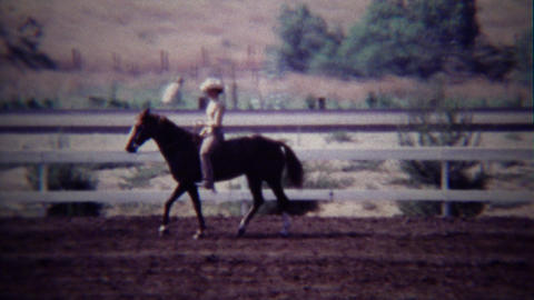 1967: Female horse rider in white costume practicing control Footage