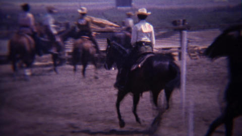1967: Group horse riders circling track in competition preparation Footage