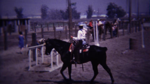 1967: Horse jumps over water obstacle course and crosses bridge Footage